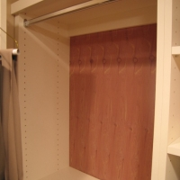 Aromatic cedar backs can be added to each cabinet, creating a moth-free environment for garments.